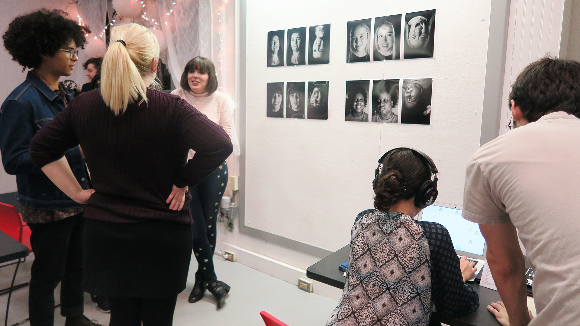Group of people looking at an exhibition of photographs