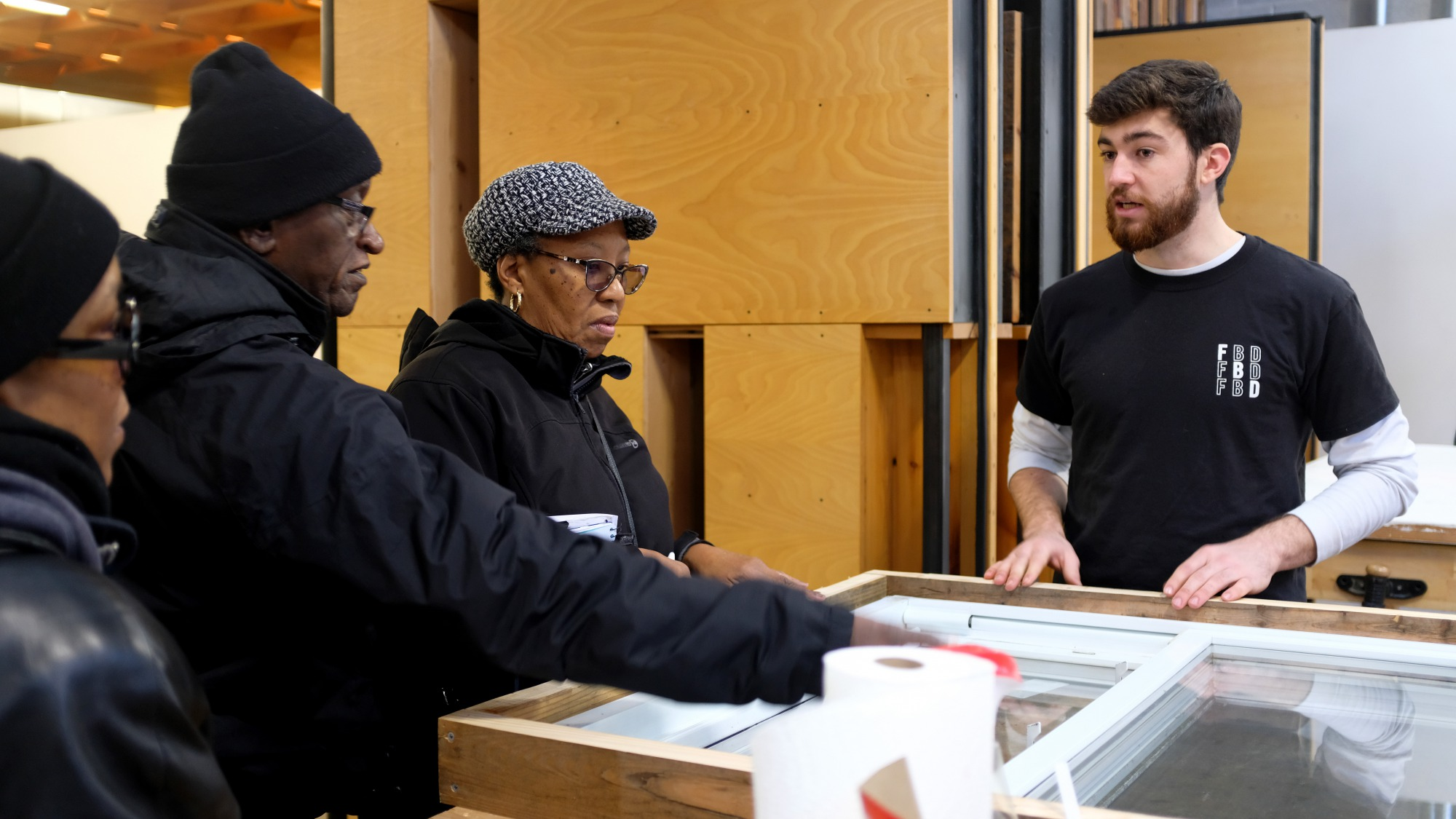 Pittsburgh residents learn about the contents of the Freedom by Design weatherization kits