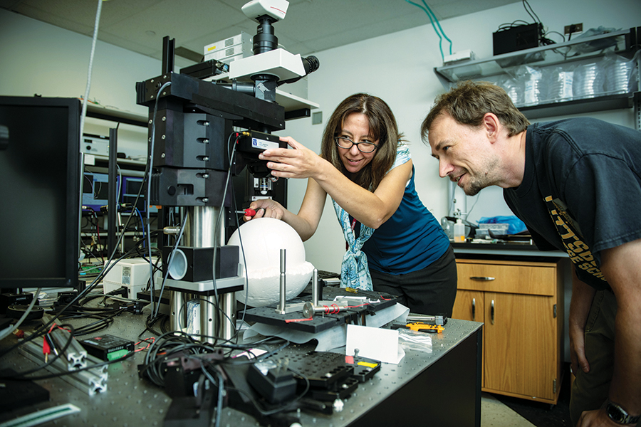 Sandra Kuhlman and student in her lab